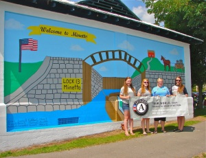 Americorps members in front of the new mural.
