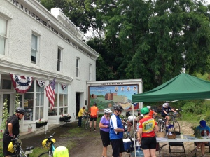Cyclists take a break during the Cycle the Erie Canal bike tour at the historic Hotchkiss Building in Lyons, Wayne County.