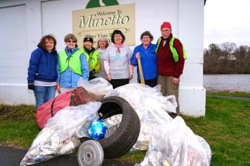 Volunteers with trash pile